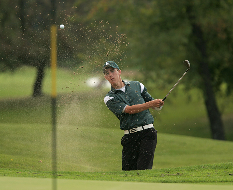 Mitch Bley from Glenbard West High School hits out of a sand trap during the Dundee-Crown boys golf invite in West Dundee on Saturday afternoon. Kevin Sherman/ksherman@dailyherald.com/© Daily Herald