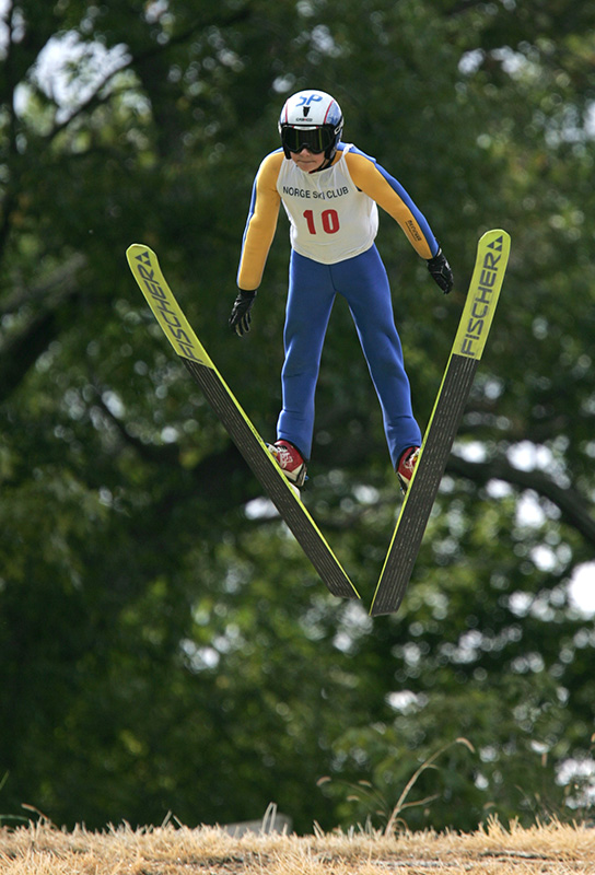 Ben Loomis (10) from the Flying Eagles Ski Club sails through the air after his jump during the Norge Ski Clubs annual Summer Ski Jump Tournament in Fox River Grove on Saturday afternoon. Kevin Sherman/ksherman@dailyherald.com/© Daily Herald