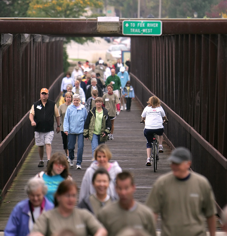 Volunteers and fundraisers start off the Fox Vally Volunteer Hospice's third annual 5K Hike for Hospice by crossing over the Fox River in Batavia on Saturday morning. Kevin Sherman/ksherman@dailyherald.com/© Daily Herald