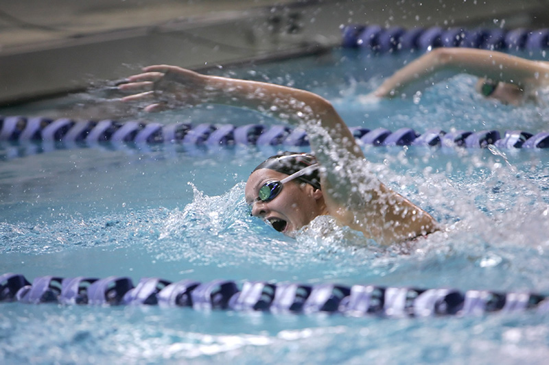 Claire Wirtz from Naperville Central competes in the first heat of the 500 yard freestyle during the 4th Annual Rosary Swimming Invite on Saturday morning. Kevin Sherman/ksherman@dailyherald.com/© Daily Herald