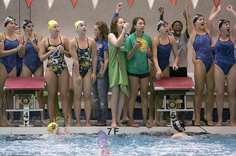 Swimmers from Neuqua Valley and Rosary cheer on their teammates Riley Schroedter, left, and Francesca Devine, right, finish the final leg of the 400 yard freestyle relay during the 4th Annual Rosary Swimming Invite on Saturday morning. Kevin Sherman/ksherman@dailyherald.com/© Daily Herald