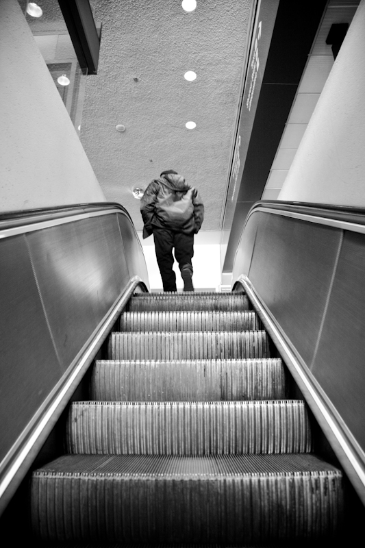 This is one of those moments I was glad to have my camera over my shoulder. I was going up the elevator and this airport worker was riding up towards the top. Luckly I was able to get to my camera and snap a few shots.