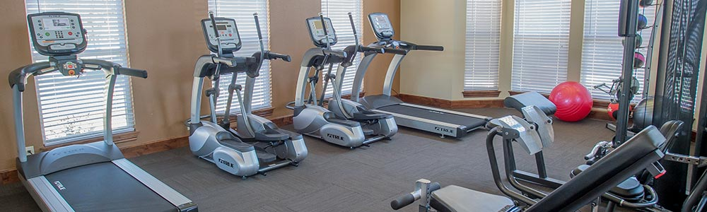 Fitness center at our Jenks apartment homes
