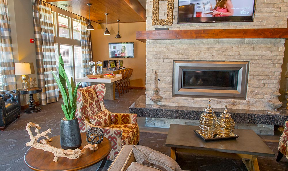 Jenks apartments feature a clubhouse with fireplace