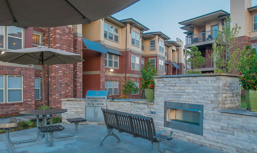 A comfortable outdoor seating area at apartments in Jenks