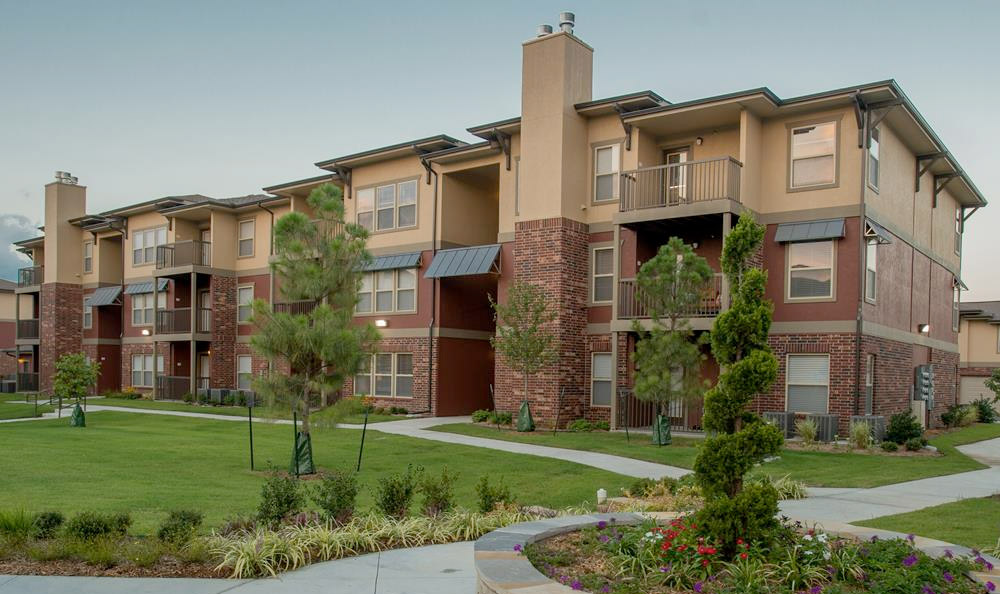 Residents can enjoy a stroll in the courtyard at their apartments in Jenks, OK