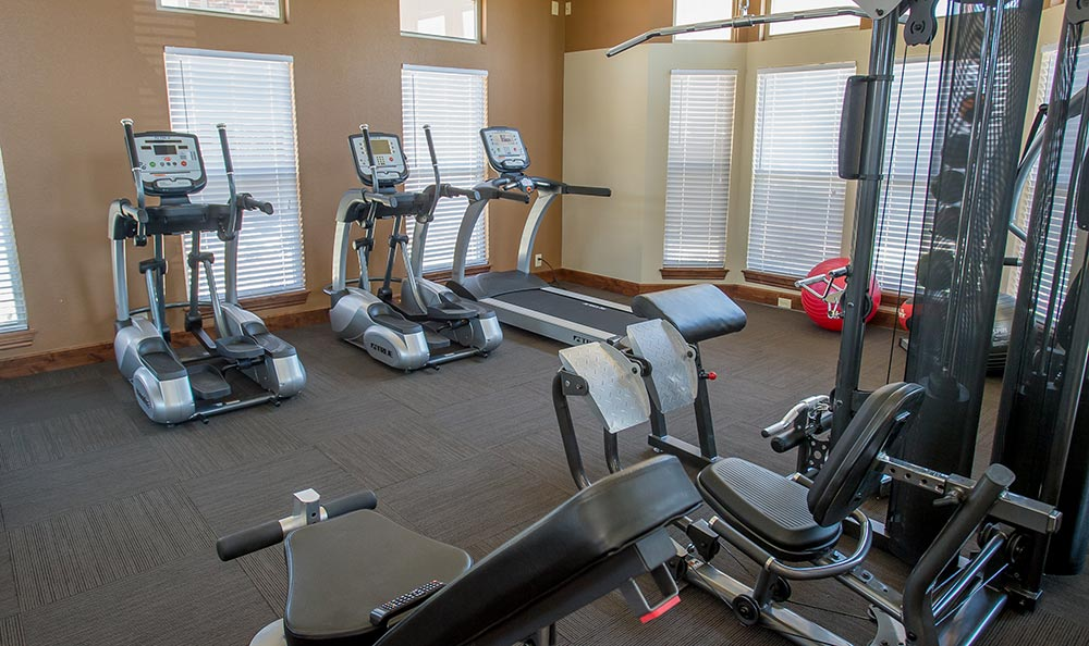 The fitness center inside our Jenks apartment homes