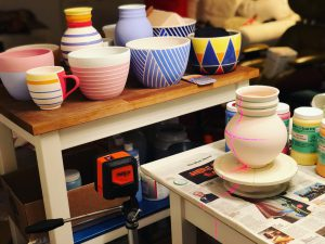 a-collection-of-jason-fox-ceramics-brightly-colored-ceramics-ceramics-being-glazed