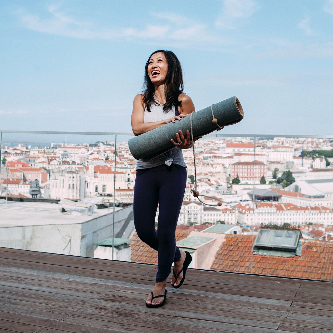 corc-yoga-founder-christin-moghadam-holding-a-corc-yoga-mat