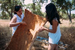 corc-yoga-founder-christine-Moghadam-discussing-cork-women-observing-cork-bark