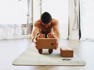 yogi-practicing-with-corc-yoga-products-yoga-pose-with-cork-block