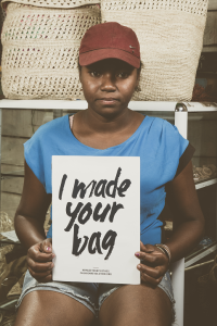 malagasy-woman-holding-sign-I-made-your-bag