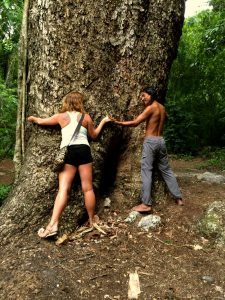 nature-guide-hugging-tree-with-young-woman