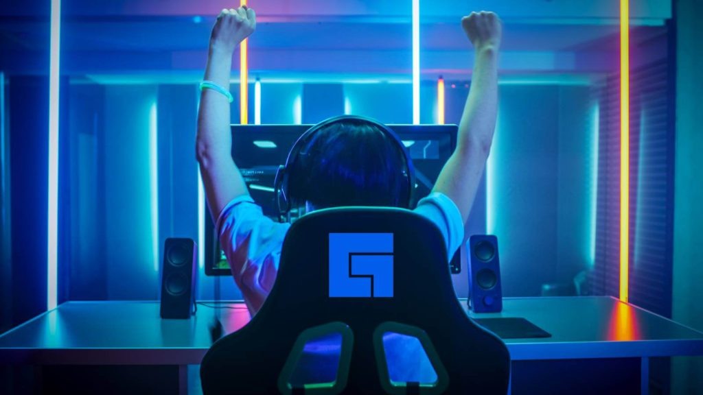 Gamer raises arms in victory sitting in facebook gaming chair