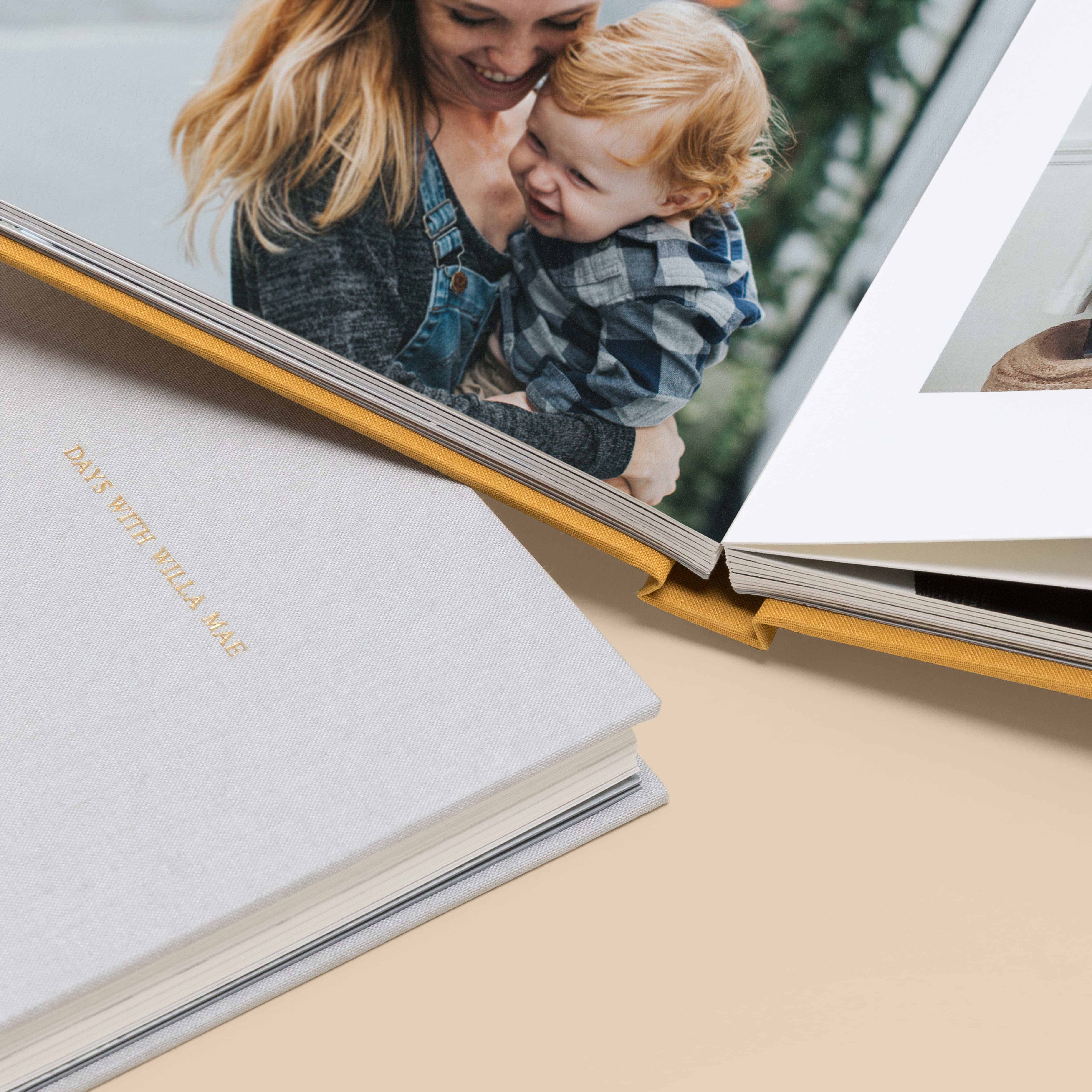 Zoomed in on Everyday Photo Book opened to image of mother holding little boy