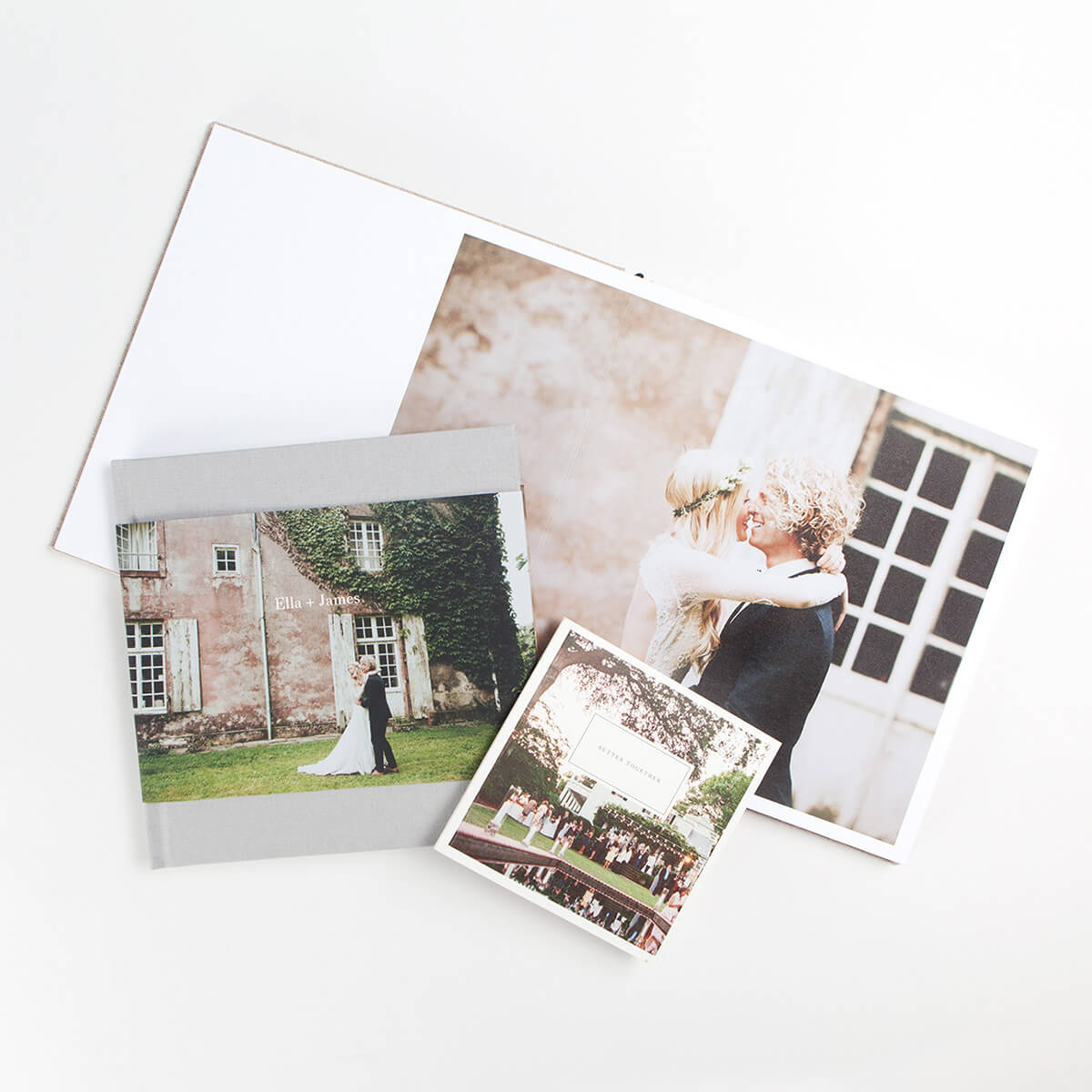 Hardcover photo book, softcover photo book, and layflat album with wedding photos