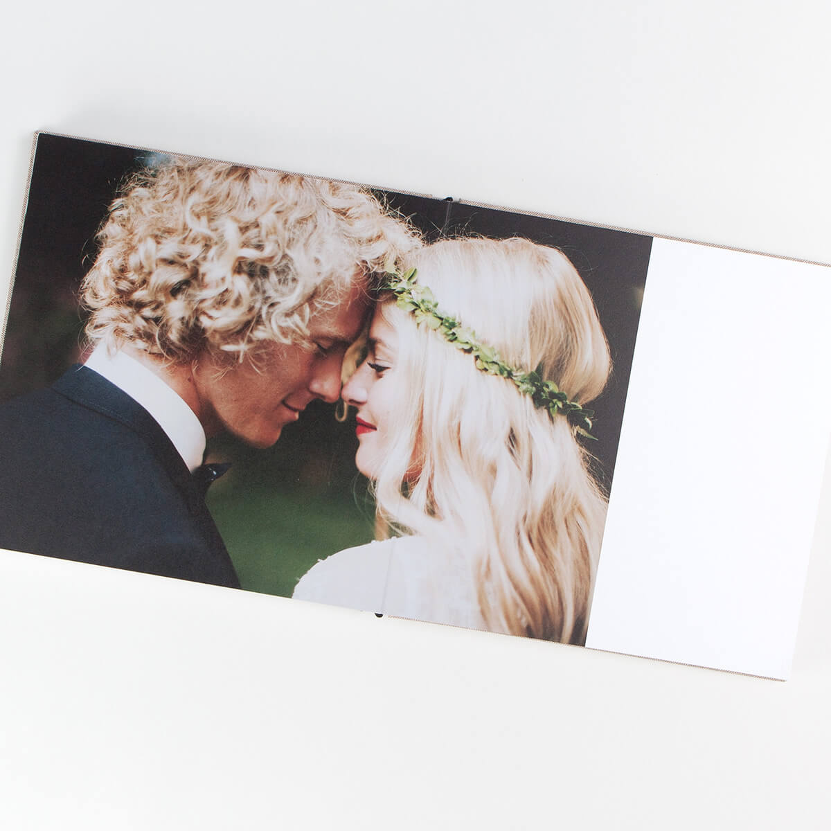 Photo book spread, one wedding photo spanning two pages