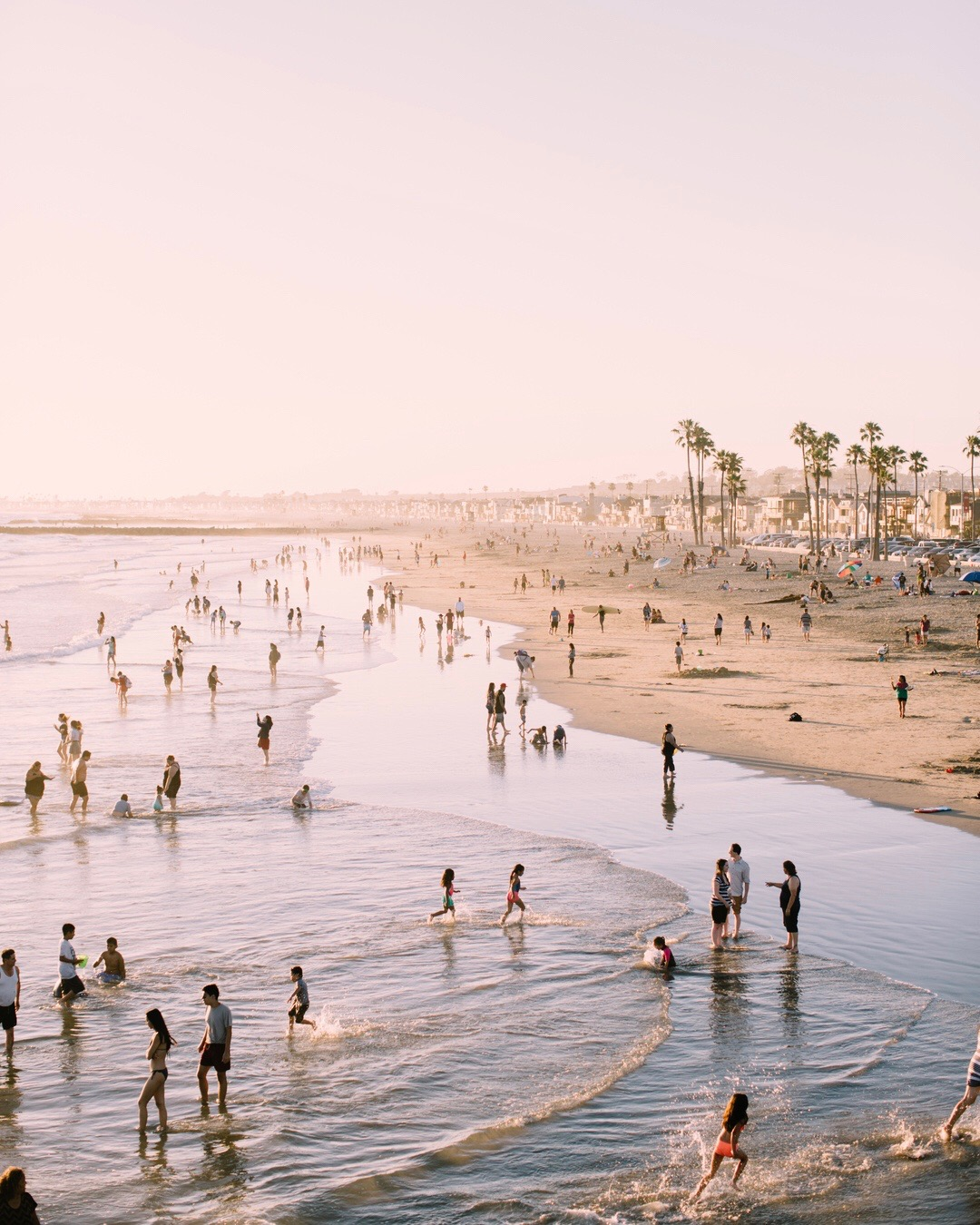 Photo of crowded beach with children playing