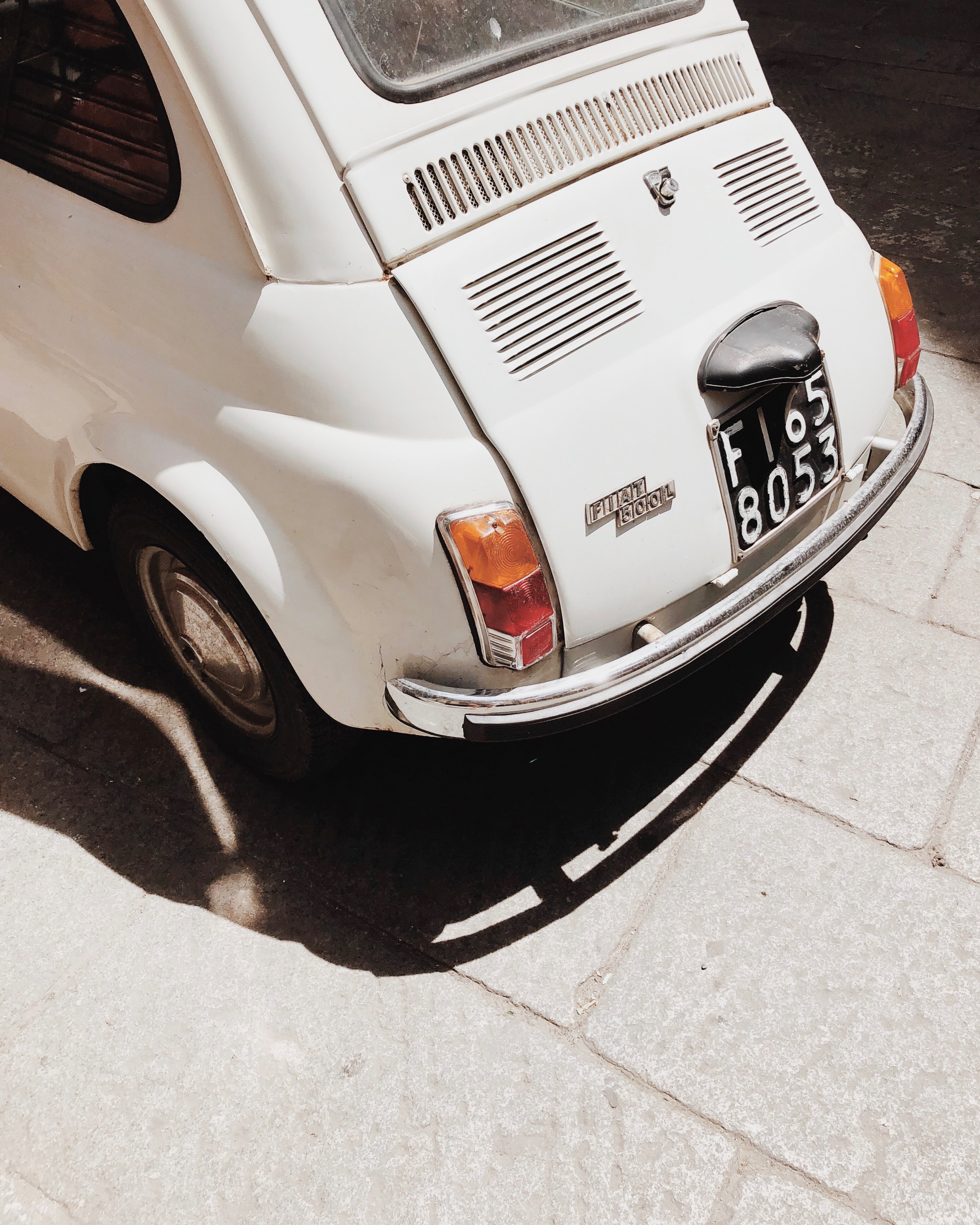 Photo of the back of an old white fiat