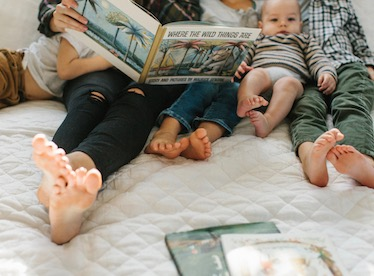 family flipping through photo book together
