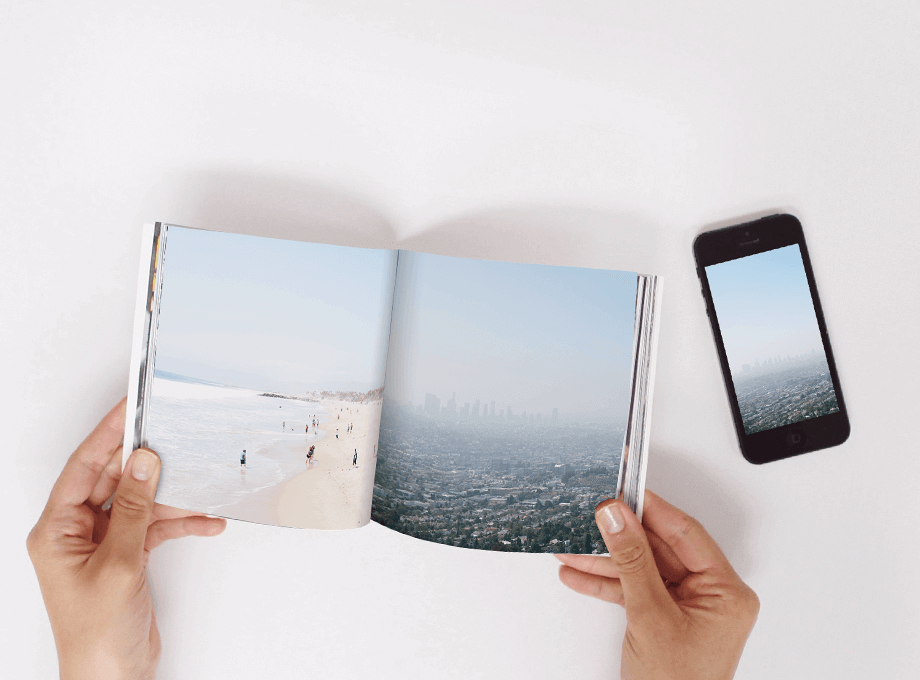 Hands flipping through Softcover Photo Book
