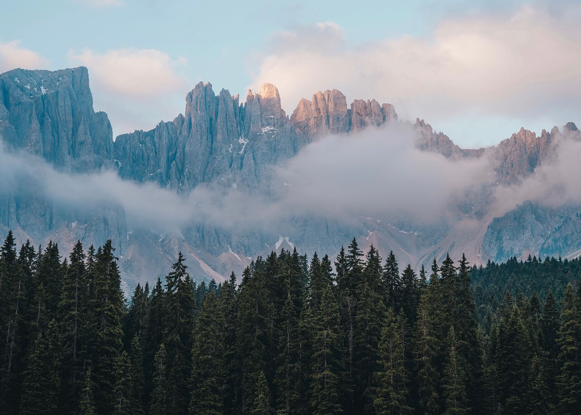Emilie Ristevski photo of craggly mountain peaks behind the clouds