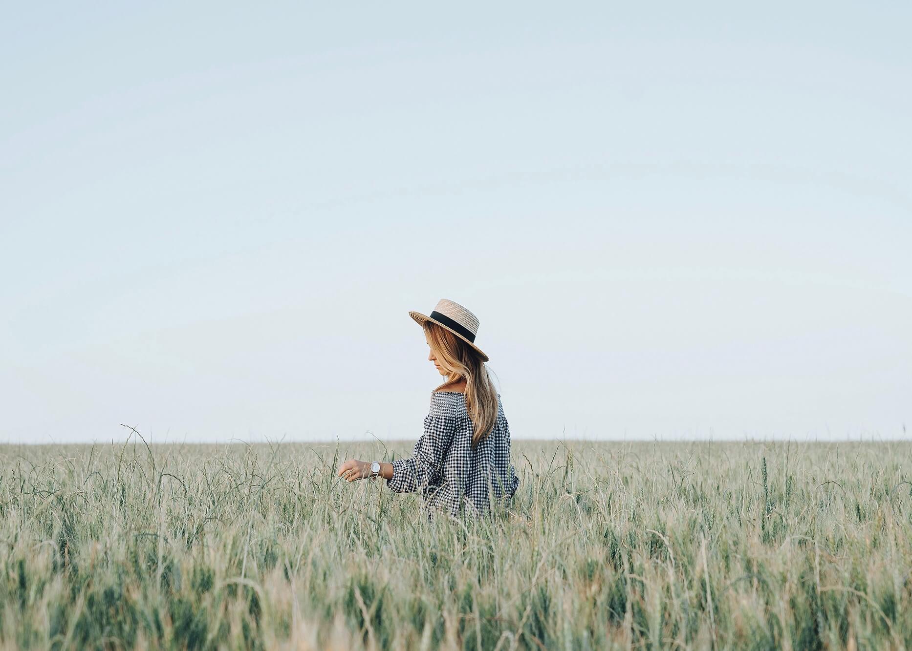 Emilie Ristevski photo of woman walking through wheat field