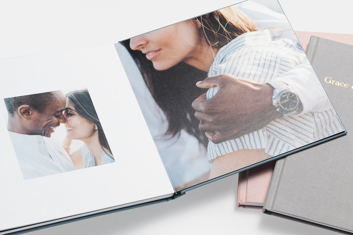 Photo book open to pictures of couple smiling at each other