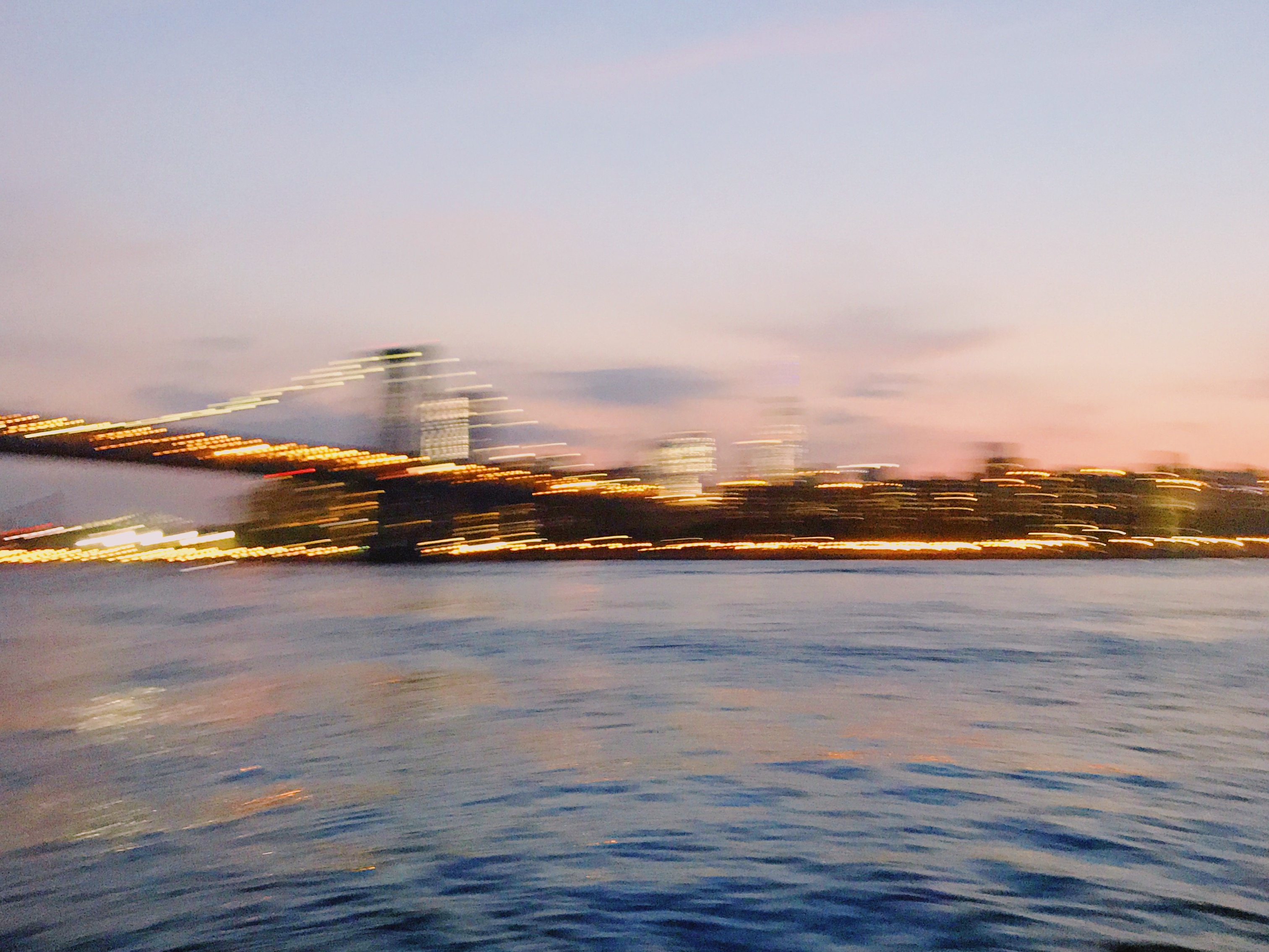 Lucy Laucht blurred photo of bridge and city skyline