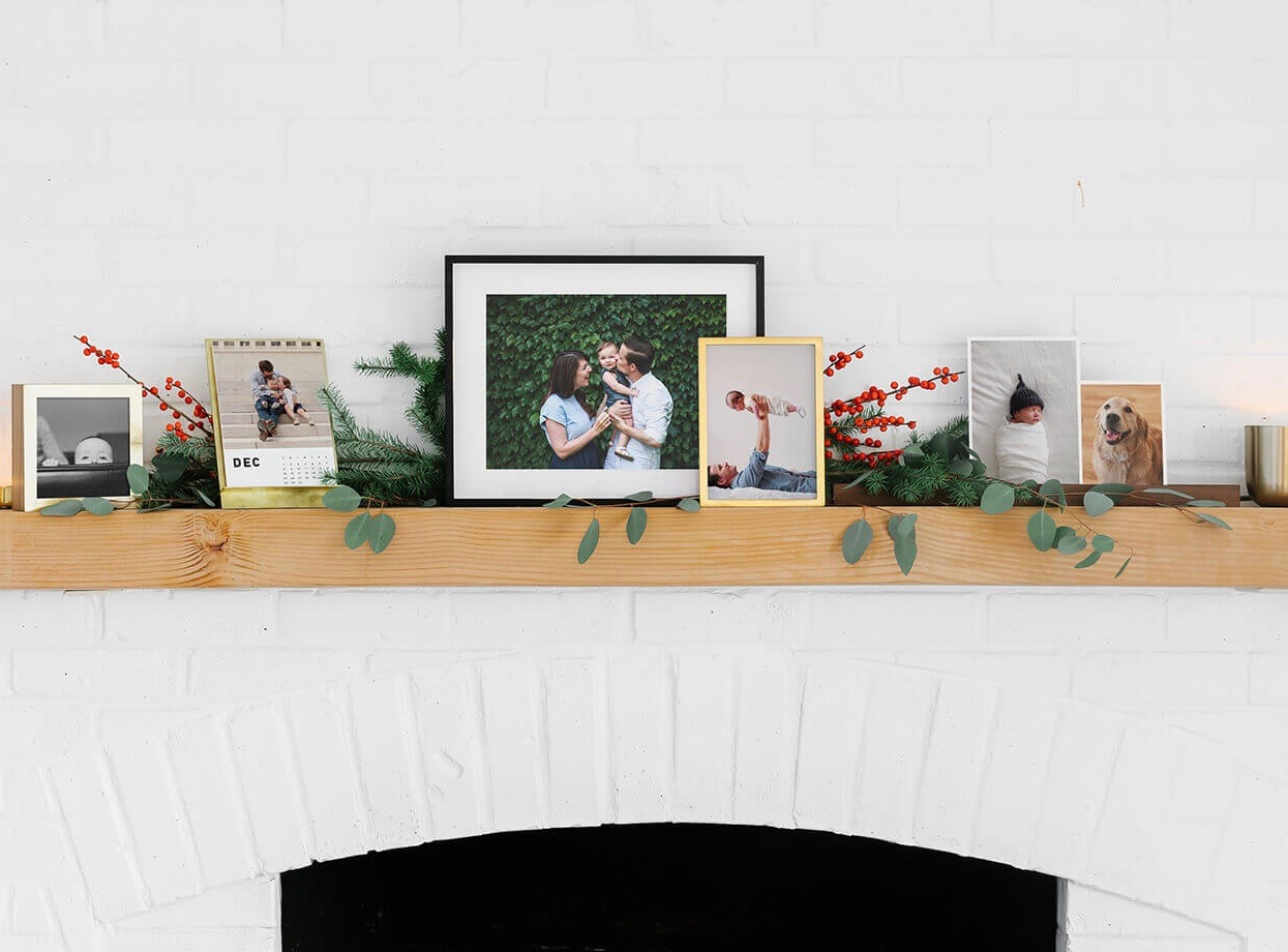 Holiday mantel filled with framed photos