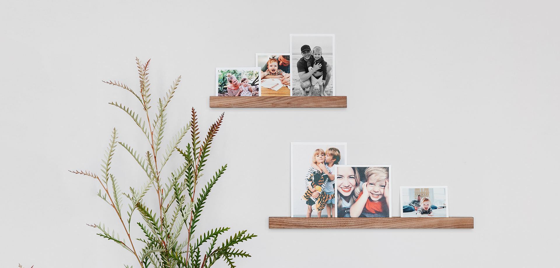 Photo display ideas in action in the form of prints on a wooden photo ledge