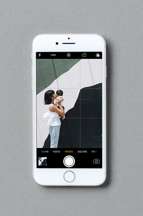 iPhone screen using grid function to line up photo of woman and baby