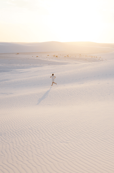 Photo of woman running across the sand that was on the iPhone screen in the previous image
