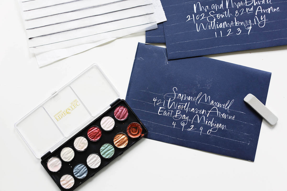 Addressing wedding invitation envelopes with transfer paper