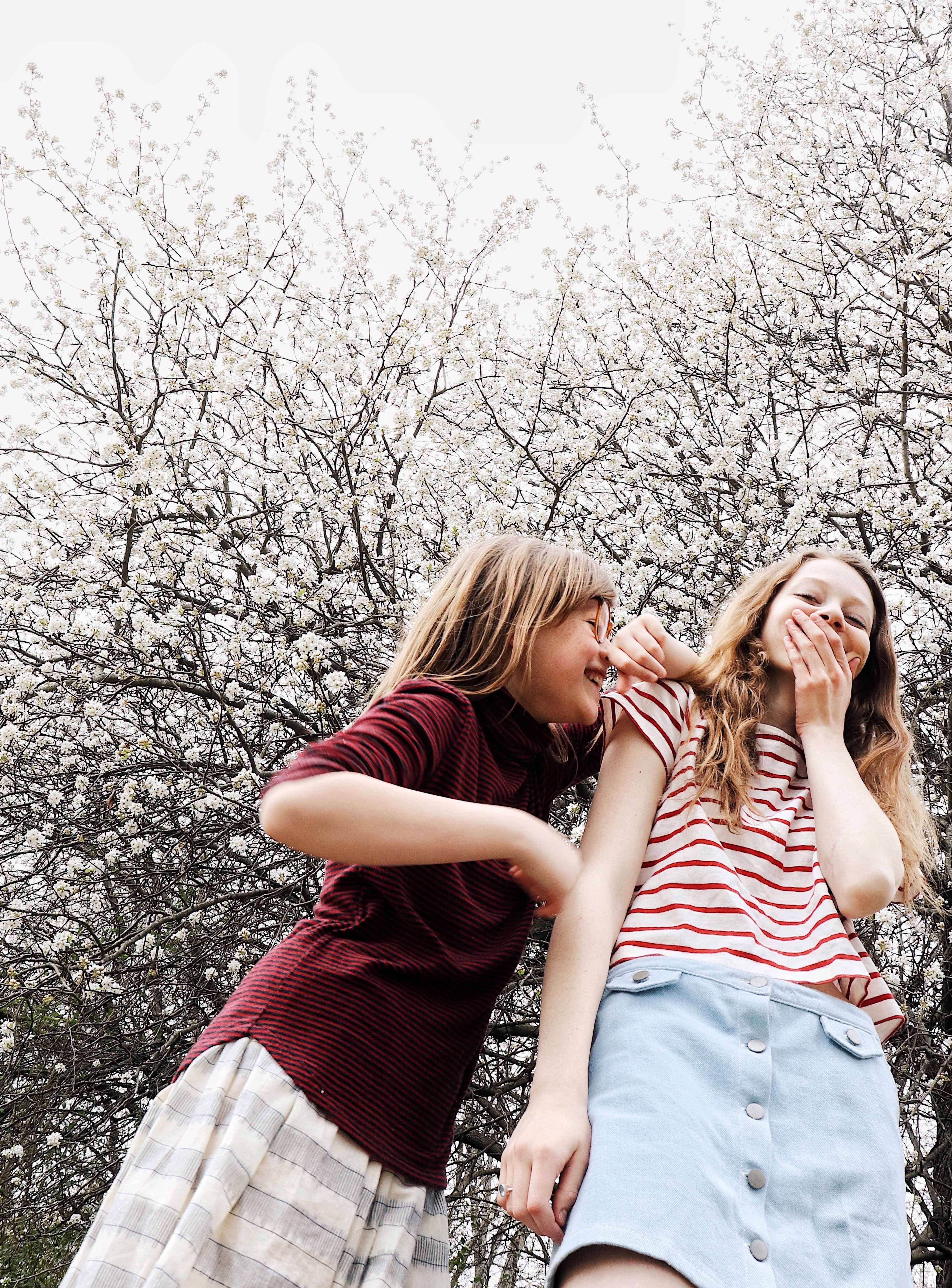 Photo of two young girls laughing and being silly
