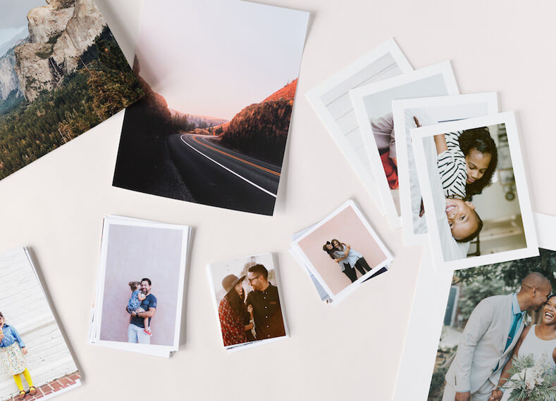 Photo prints scattered on tabletop