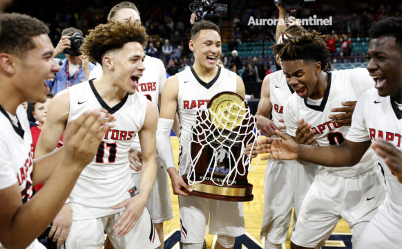 Eaglecrest team members jubilantly react to winning the 5A State Championship game against George Washington March 11 at the Denver Coliseum. Eaglecrest overcame a six-point deficit at the end of the first half defeating George Washington 53-47. (Photo by Philip B. Poston/Aurora Sentinel)