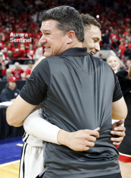 Eaglecrest Head Coach and senior Colbey Ross embrace after what will be their final game for Eaglecrest after winning the 5A State Championship game, March 11 at the Denver Coliseum. Eaglecrest overcame a six-point deficit at the end of the first half defeating George Washington 53-47. (Photo by Philip B. Poston/Aurora Sentinel)