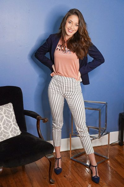 cute striped pants in front of blue wall