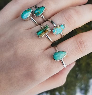 assorted turquoise and silver rings