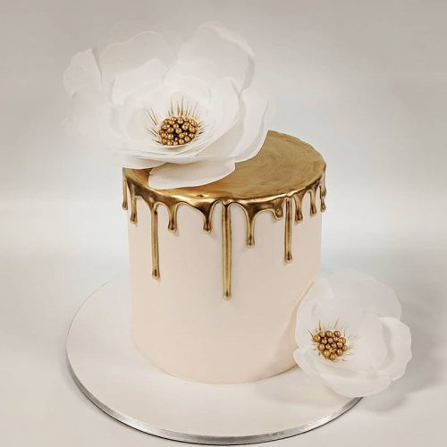 gorgeous gold and flowers cake
