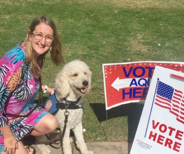Amanda Lee and service dog vote here Four Paws to Independence Grapevine Texas