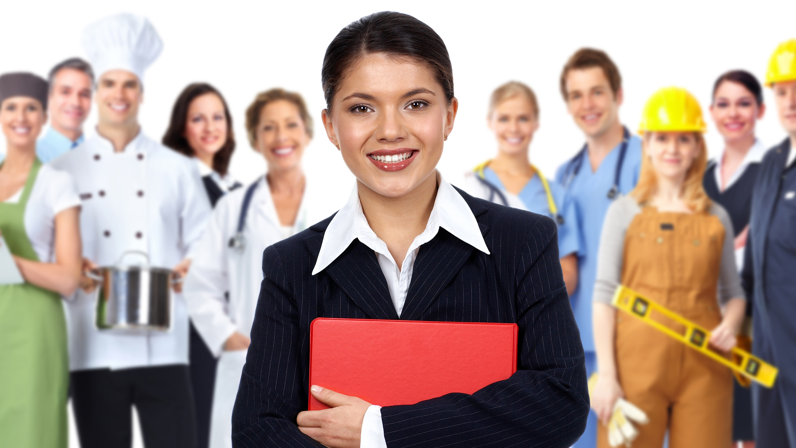 Young business woman standing in front of a group of young people from various Job Corps career paths