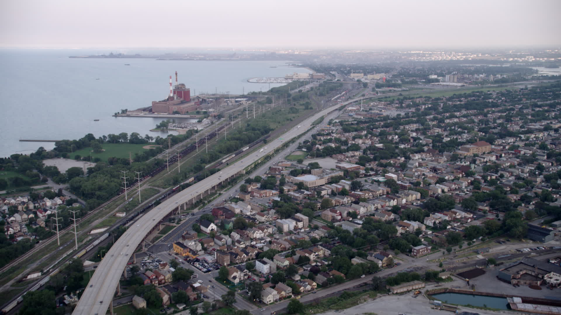 5K stock footage aerial video of bird's eye of grain elevation, tilt up to  Chicago Skyway and freeway, East Side Chicago, Illinois Aerial Stock