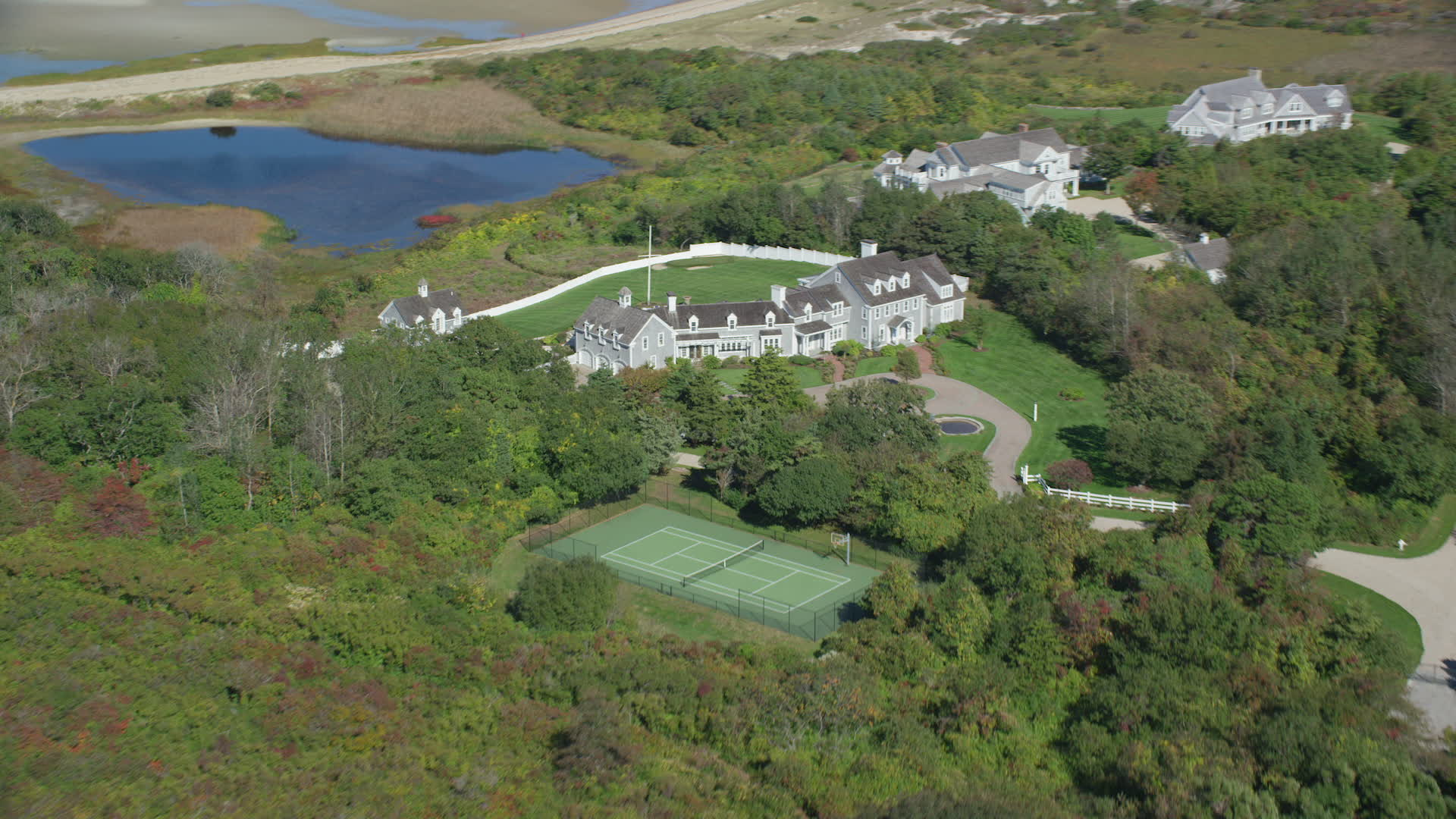 6K stock footage aerial video flying by mansion, tennis court, swimming  pool, Dennis, Massachusetts Aerial Stock Footage AX143_165 | Axiom Images