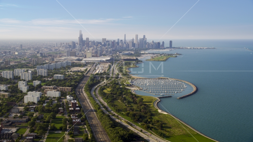 The Downtown Chicago skyline and Lake Michigan, on a hazy day, Illinois Aerial Stock Photo AX0001_014.0000123F | Axiom Images