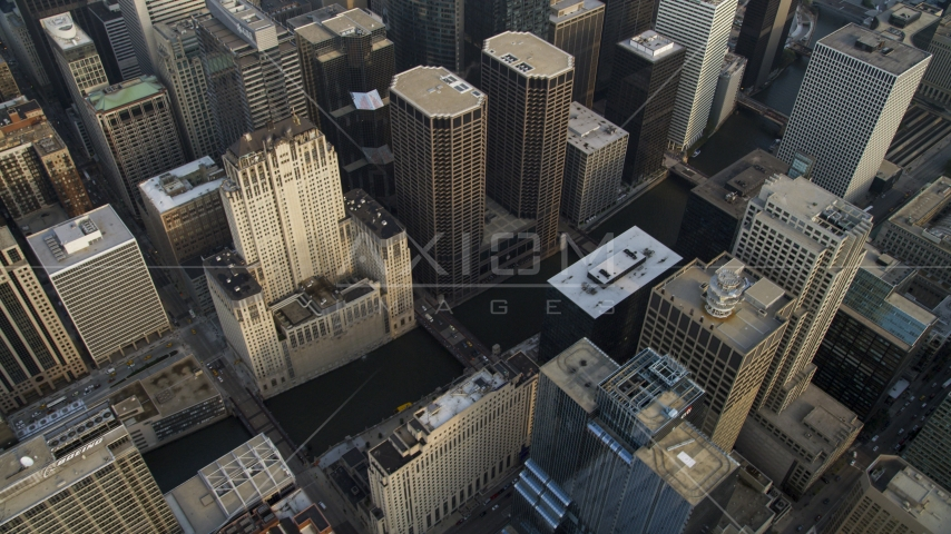 City buildings surrounding the Chicago River in Downtown Chicago, Illinois Aerial Stock Photos | AX0001_045.0000000F