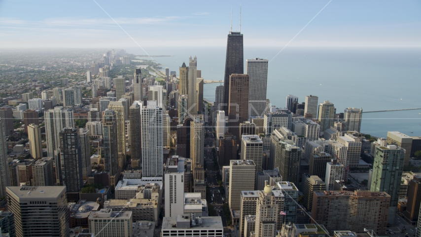 A view across downtown at John Hancock Center, Downtown Chicago, Illinois Aerial Stock Photo AX0001_049.0000424F | Axiom Images