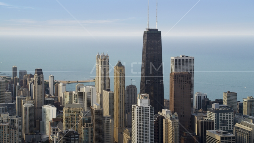 Skyscrapers around John Hancock Center in Downtown Chicago on a hazy day, Illinois Aerial Stock Photo AX0001_054.0000000F | Axiom Images