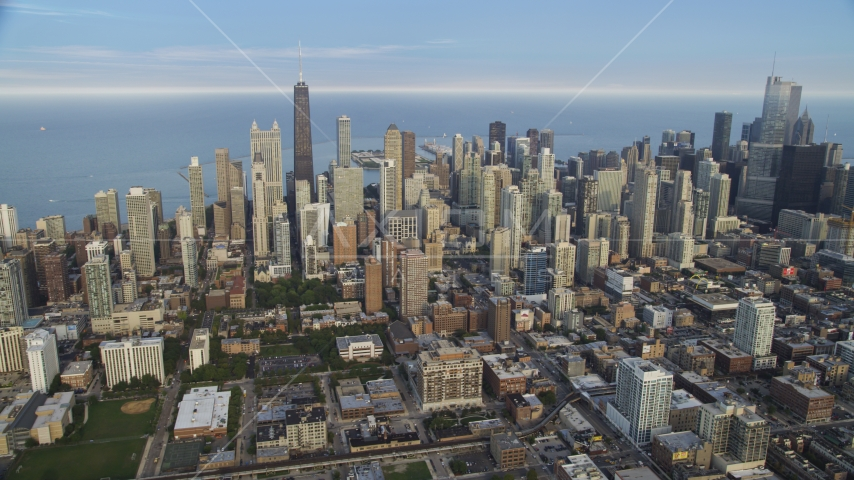 Downtown Chicago skyscrapers on a cloudy day, Illinois Aerial Stock Photo AX0001_056.0000342F | Axiom Images
